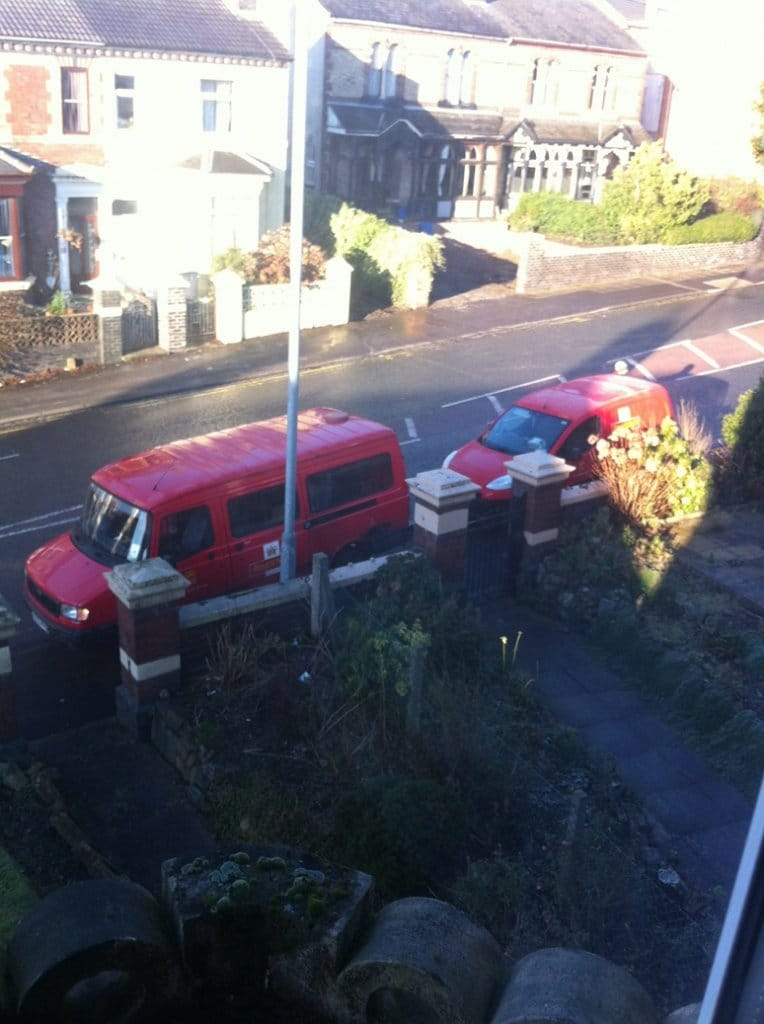 2 Royal Mail vans delivering to the same place
