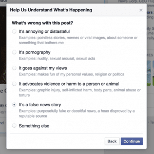 Facebook report hoax option
