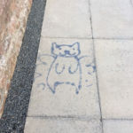 graffiti on a recycled paving flag outside Turriff Library